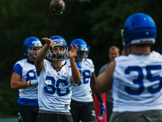 July 29, 2017 - Riley Patterson, a kicker for the University of Memphis football team, throws a ball to a teammate during practice at the Billy J. Murphy Athletic Complex on Saturday.