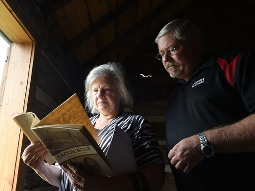 Dr. Ruth Hawkins, (left) director of the Arkansas Heritage Sites with Arkansas State University Jonesboro talks with Baxter County Quorum court member Kevin Bodenhamer about the Wolf House on Thursday, July 17, 2014. Hawkins visited the historic structure to determine if it could be included in ASU's Arkansas Heritage Studies program.
