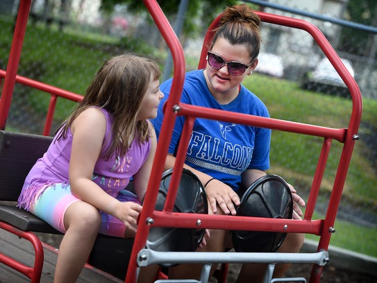 Autumn Heisey, 17, interacts with one of the many children