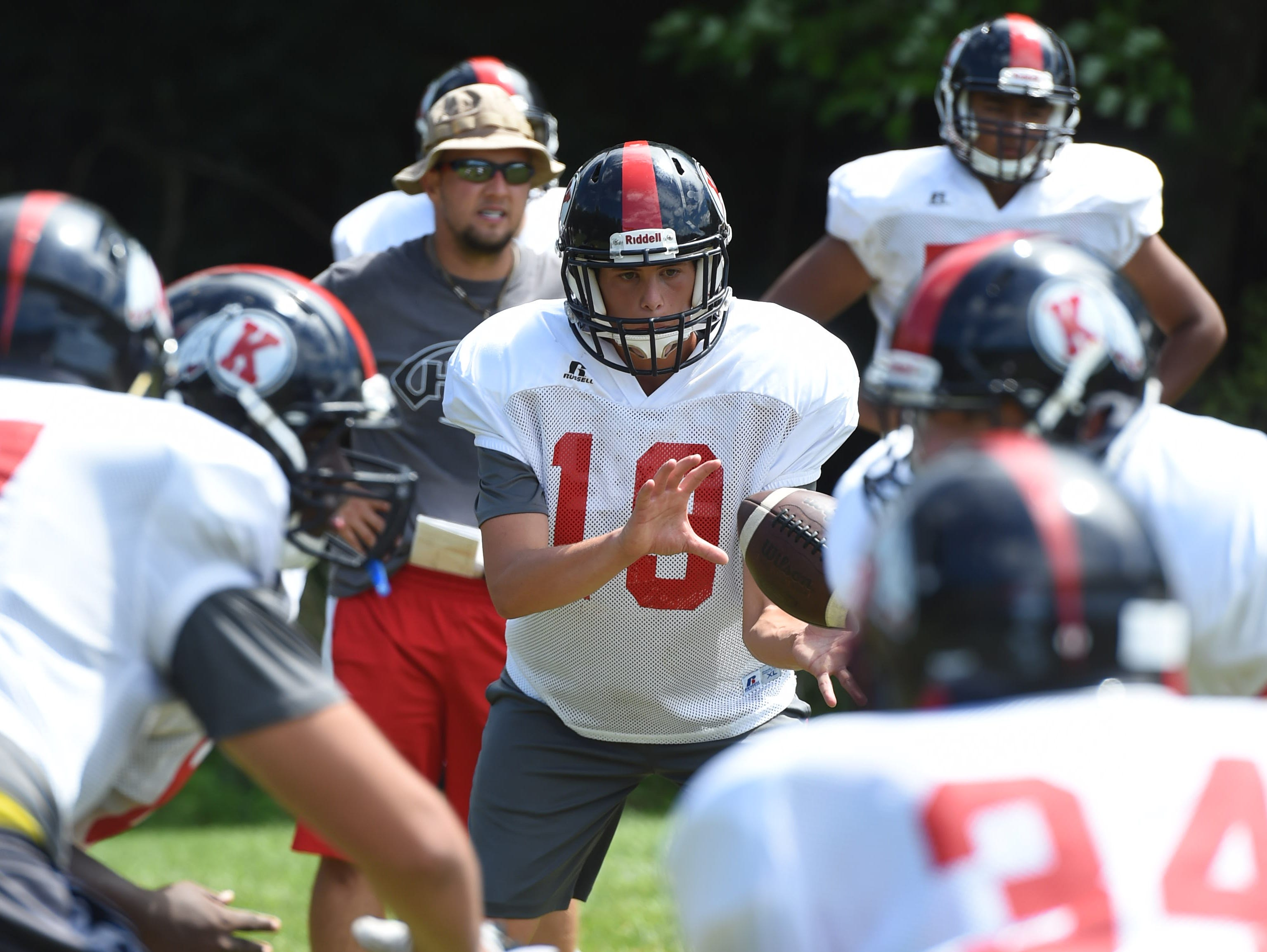 Roy C. Ketcham's Sam Vivace receives the ball during preseason practice on Wednesday. Vivace, a senior, was practicing offensive drills. Ketcham coach Bryan Hogan has not yet decided on his quarterback.