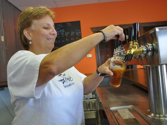 Delmar-based 3rd Wave Brewing Co. co-owner Lori Clough pours a beer. The brewery now offers a beer named Beach Juice.