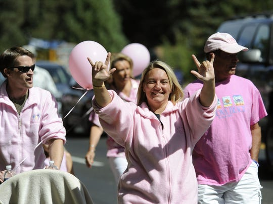 The crowd was happy as they walked in the Pink Ribbon Parade to honor Jaycee Lee Dugard in South Lake Tahoe on Sunday, Sept. 6, 2009.