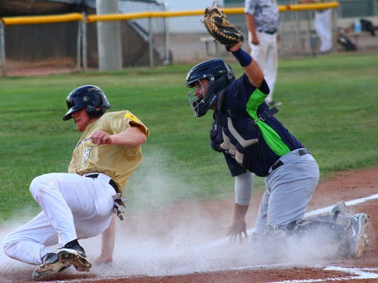 Roswell catcher Cody Coffman tags out Zac Johnson during the first inning Wednesday at the Griggs Sports Complex.