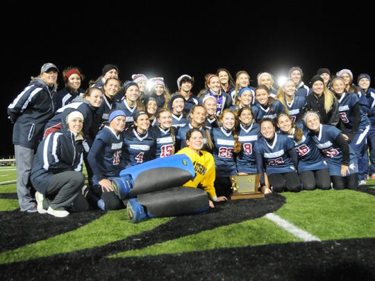 Eastern's Field Hockey team celebrates after winning state Group 4 championship by defeating Bridgewater-Raritan 5-1 Saturday.