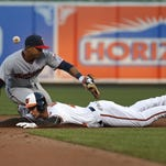 Baltimore Orioles' Joey Rickard beats a throw to Minnesota Twins shortstop Eduardo Escobar (5) for a double in the fifth inning of an opening day baseball game in Baltimore, Monday, April 4, 2016. (AP Photo/Patrick Semansky)