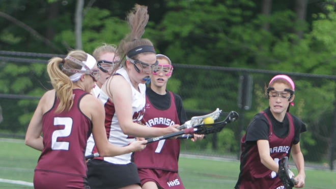 Action between Nyack and Harrison during a Section 1, Class B, first round game at Nyack High School on Wednesday, May 18th, 2016. Nyack won 15-7.