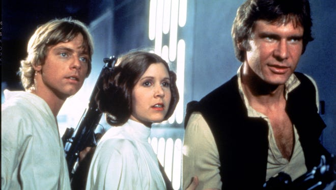 """This scene from the 1977 George Lucas """"Star Wars"""" movie shows Mark Hamill as Luke Skywalker, from left, Carrie Fisher as Princess Leia Organa and Harrison Ford as Han Solo."""