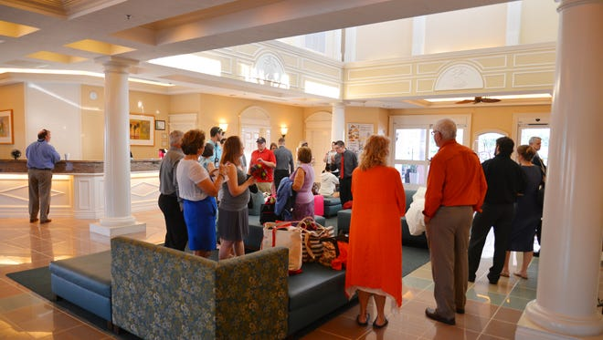 The lobby at the Radisson Resort at the Port is busy with activity every morning with guests checking out or waiting for a bus to the cruise lines.