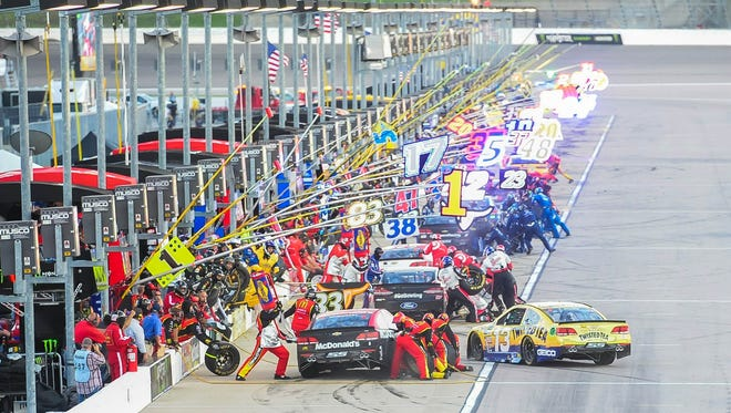 Pit road is busy early in the Go Bowling 400 at Kansas Speedway.