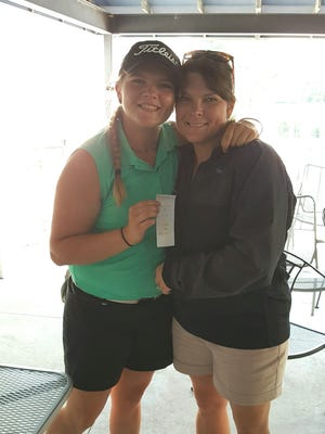 Yorktown golfer Reece Malapit poses with her mother, Barbie Durham, after the Lapel Regional