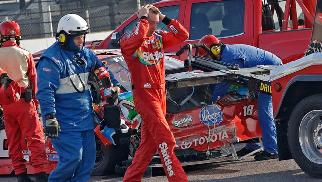 Monster Energy NASCAR Cup Series driver Kyle Busch (18) holds his head in disappointment as he leaves the track after a crash during the Brickyard 400 at Indianapolis Motor Speedway on Sunday, July 23, 2017.