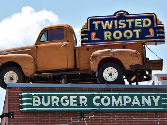 A decorative truck sits on top of the roof at Twisted Root Burger Company on July 6, 2018 on Chadbourne St.