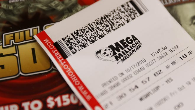 A Mega Millions lottery ticket rests on the shop counter at the Street Corner Market in Cincinnati.