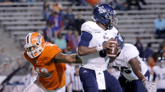 Rice quarterback Driphus Jackson is rushed by UTEP defensive end Roy Robertson-Harris in the first half of their Conference USA game Friday, November, 6, 2015 at the Sun Bowl in El Paso, Texas.