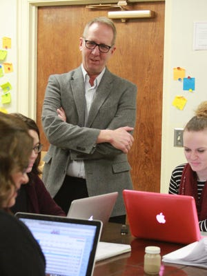 Dave Versteeg, superintendent, Montezuma Community Schools, talks with teachers recently at the school. Versteeg is leaving to accept the position of superintendent at Mason City Community Schools. His last month will be June 2017 when his contract expires.