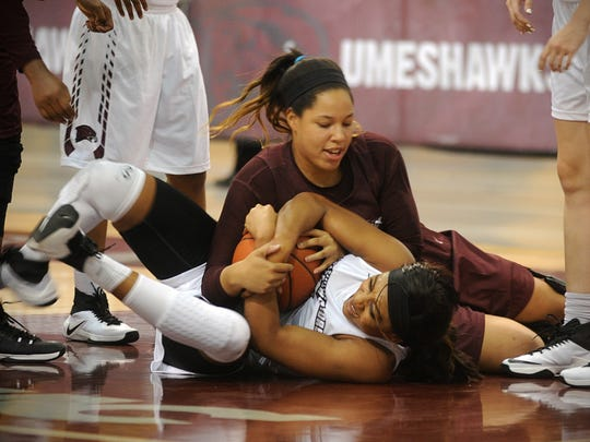 Eastern Shore players Tori Morris (maroon) and Chioma Nkpuechina (white) wrestle for a loose ball during a scrimmage at Hawk Hysteria on Friday, Oct. 14, 2016, at the William P. Hytche Athletic Center.