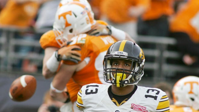Iowa defensive back Greg Mabin (13) reacts after Tennessee trickery led to a Vic Wharton touchdown and a 21-0 lead.
