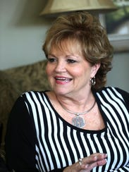 Deb Insell will watch her husband, Rick Insell, coach