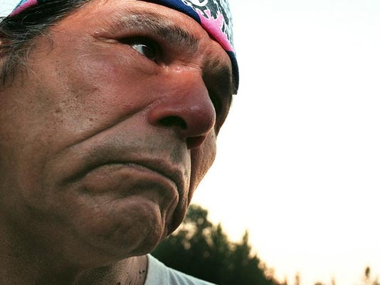Text: sacredrun.9.tempo-7/3/96-dennis banks talks about the sacred run of 1996, the environment and the aikm movement. cincinnati enquirer photo by yoni pozner.yp