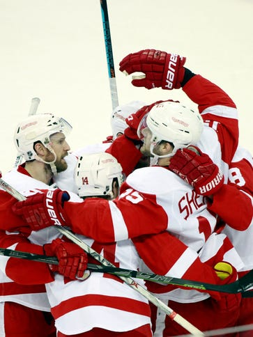 Detroit Red Wings center Riley Sheahan (15) is congratulated