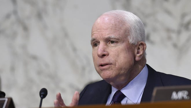 Senate Armed Services Chairman Sen. John McCain, R-Ariz., asks defense officials questions about Russian-made rockets for military satellites at a hearing on Capitol Hill on Jan. 27, 2016,