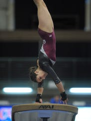 Madison's Jocelyn Krouse competes in the Class A Vault