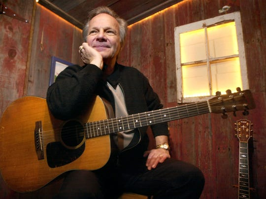 Bobby Vee poses with a guitar.