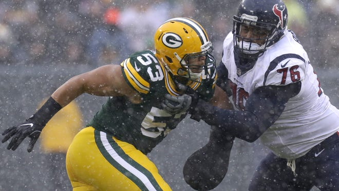 Green Bay Packers outside linebacker Nick Perry (53) is blocked by Houston Texans tackle Duane Brown (76) during the third quarter of their game Sunday, December 4, 2016 at Lambeau Field in Green Bay, Wis. The  Green Bay Packers beat the Houston Texans 21-13.  MARK  HOFFMAN/MHOFFMAN@JOURNALSENTINEL.COM