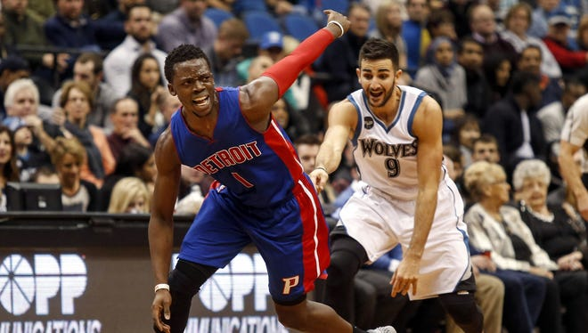 Pistons guard Reggie Jackson reacts after driving into Minnesota Timberwolves guard Ricky Rubio on Nov. 20, 2015.
