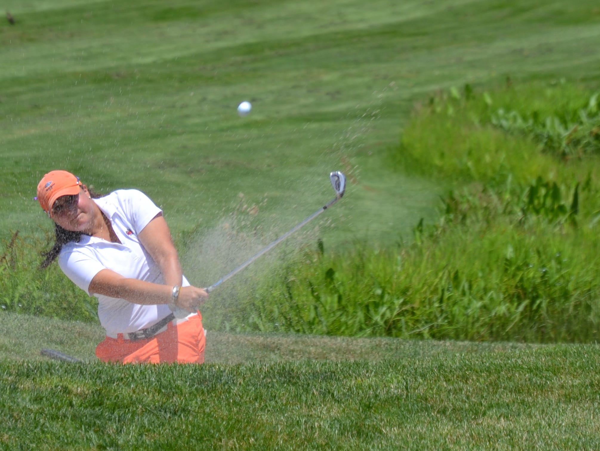 Westchester Country Club member Alexis Hios escapes a bunker alongside the 15th hole at Willow Ridge during the final round of the Lincoln Met Women's Open at Willow Ridge Country Club.