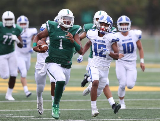 West Bloomfield's Bryce Veasley runs by Walled Lake