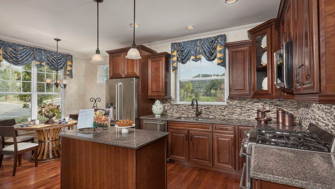 The open floor plan and spacious upscale kitchen of the Sherwood model make it a popular choice at The Meadows at Panther Valley.