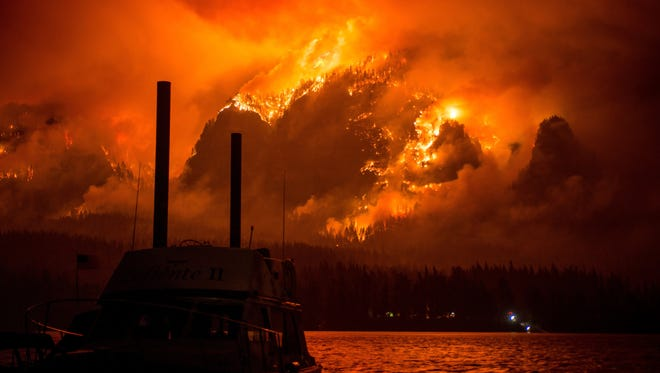 This Monday Sept. 4, 2017, photo provided by KATU-TV shows the Eagle Creek wildfire as seen from Stevenson Wash., across the Columbia River, burning in the Columbia River Gorge above Cascade Locks, Ore. A lengthy stretch of highway Interstate 84 remains closed Tuesday, Sept. 5, as crews battle the wildfire that has also caused evacuations and sparked blazes across the Columbia River in Washington state. (Tristan Fortsch/KATU-TV via AP)