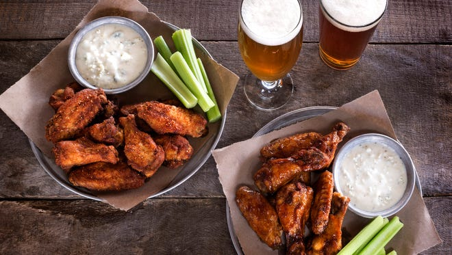Wings come dry-rubbed or doused in Buffalo, garlic parmesan, hot honey barbecue or Korean spicy sauces at World of Beer, which opened April 23, 2018, on Mass Ave. in Indianapolis.