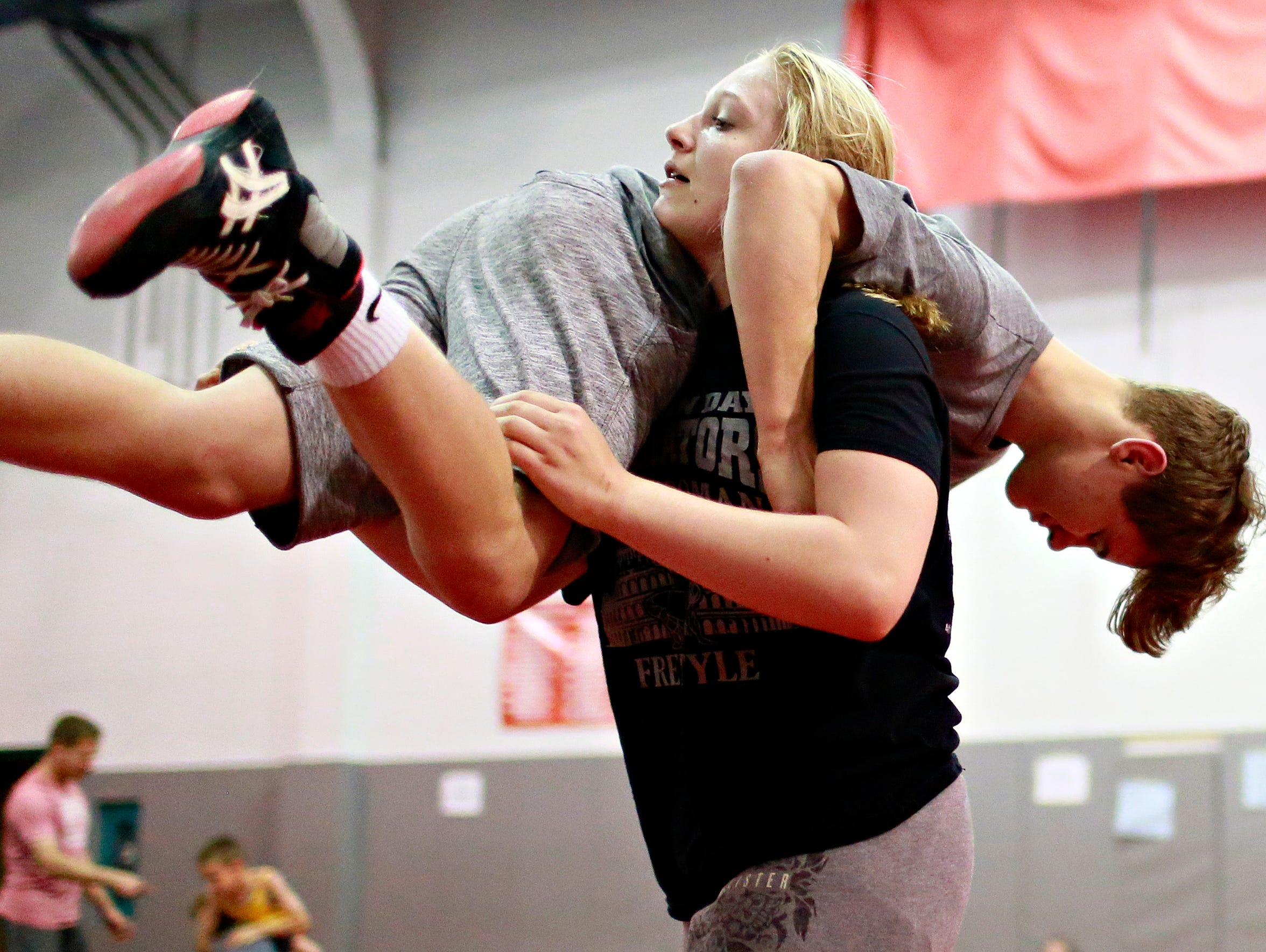 Tiffani McNelis, 14, of Stewartstown, lifts Mason Lewis,