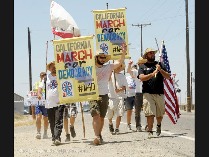 "About a dozen marchers from 99Rise walked Monday during the Pixley to Tulare 17 mile leg of the California March for Democracy ""480 Miles. 37 Days. 1 Mission."" They started at Pixley Park in Pixley and ended at Zumwalt Park in Tulare. They are pictured marching along Paige Avenue near South I Street south of Tulare."