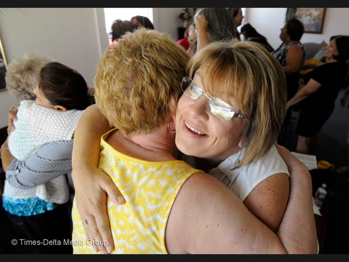 Ruthann Bailey Miller, 49, right, gets a hug following a group session at Sisterhood of Grace in Visalia. She founded the nonprofit to provide healing and support for women in crisis. She reaches them from her own experiences, lessons learned and faith-based group sessions and life coaching.