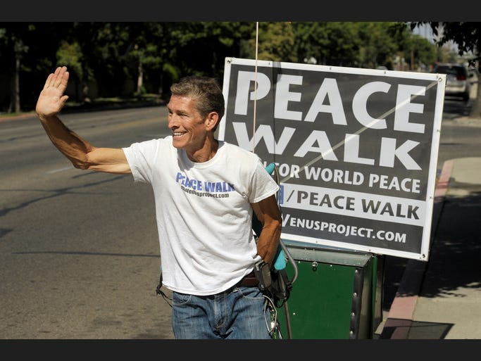 Luke Wonderly, 56, of Bakersfield plans to walk to the 48 contiguous state capitals and then hopefully meet with the President with a plan for World Peace during his Peace Walk. Luke started his walk from Bakersfield April 26, became very sick during his walk making it to Strathmore, and took a month to recover. He started back up from Starthmore about a week ago and is now making his way through Visalia towards Fresno. Luke is pictured walking along Walnut Avenue near Conyer Street in Visalia. His sign and trailer that he pulls along weighs about 80 pounds. Luke tries to wave to everyone that passes by and spread his message as much as he can.   You can follow his progress at https://www.facebook.com/pages/Peace-Walk/263029003853894?fref=photo