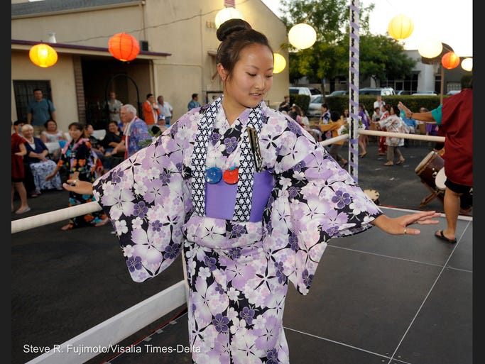 Visalia Buddhist Church kicked off the Obon season for Central California on Saturday, June 28 at 514 E. Center St., Visalia. There was traditional dancing and the Visalia Buddhist Church's Koru Taiko and the Fresno Gumyo Taiko performed drumming music. Pictured- Jordan Tonooka, of Visalia, dances during the Visalia Obon Festival.