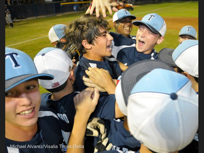Tulare celebrates after winning 1-0 against Bullard during the championship game of Pacific Southwest Regional Tournament 12-60 year old division at Art Picasno field on July 24, 2014
