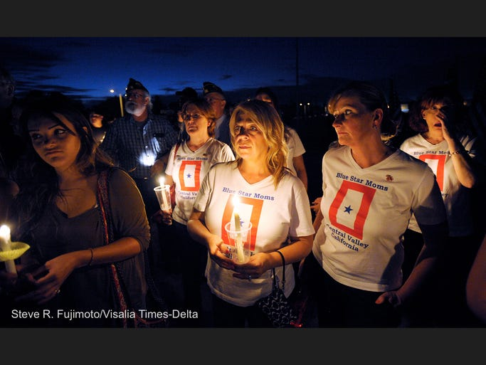 Pictured- Rhonda Gilmore, center, and other members of the Central Valley Blue Star Moms, showed their support Saturday night for a candlelight vigil for Army Pfc. Keith Williams, 19, who died while fighting in Afghanistan, at El Diamante High School, Visalia. Keith graduated from El Diamante High School in 2013.