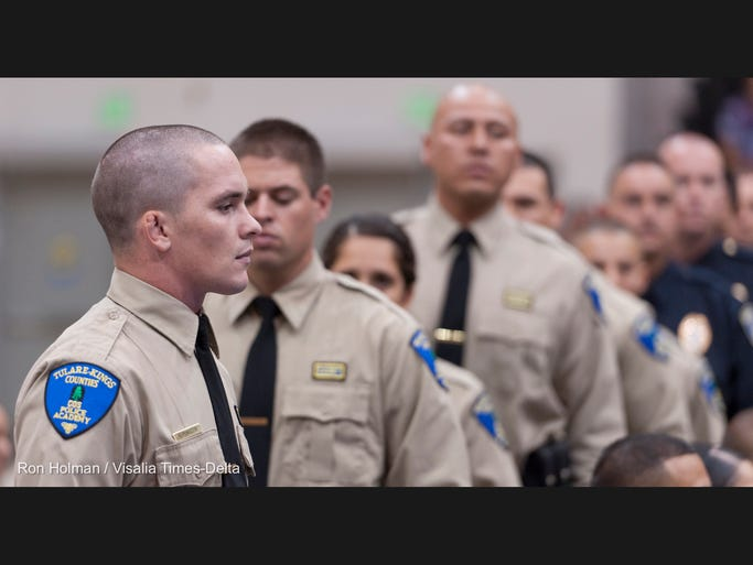 Cadet William B. Pendleton waits to be called during graduation exercises for the 131st Basic Academy Class of the Tulare-Kings Counties Police Academy at College of the Sequoias on Thursday, July 31, 2014.