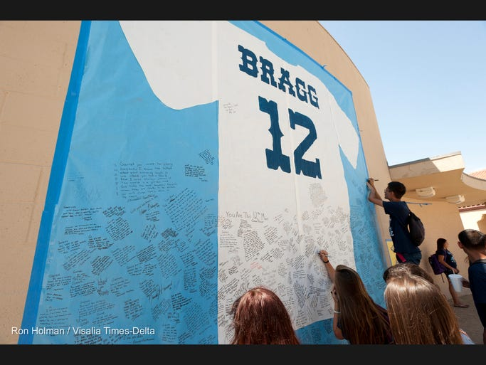 Students mourn the loss of classmate Garrett Bragg at Redwood High School Monday, August 25, 2014. Bragg was killed Saturday morning in a single-car accident on Highway 99 while on his way to help at the Tulare County Fair.
