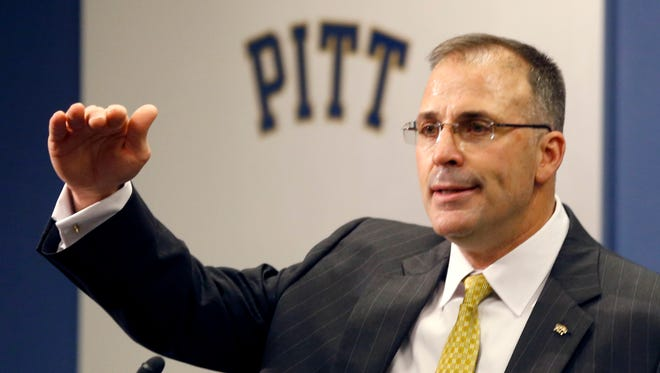 Pat Narduzzi, the longtime Michigan State defensive coordinator, speaks at a news conference where he was introduced as the new head coach at Pittsburgh on Friday, Dec. 26, 2014.