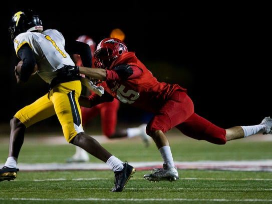 Immokalee's Nico Turrubiartez (45) attempts to bring