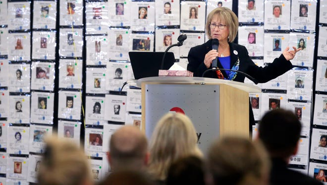 Patty Wetterling, mother of abducted Jacob Wetterling, stands before a wall of photos of missing people as she makes a keynote address at the fourth annual Missing Persons Awareness event Saturday at the Fox Valley Technical College Public Safety Training Center in Greenville. She serves as president of the Jacob Wetterling Resource Center.