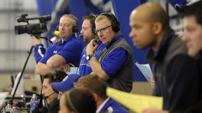 John Stiegelmeier (center), SDSU Head Coach, views the game from the press box during the SDSU spring football at the Sanford Jackrabbit Athletic Complex in Brookings, S.D., Saturday, April 25, 2015.