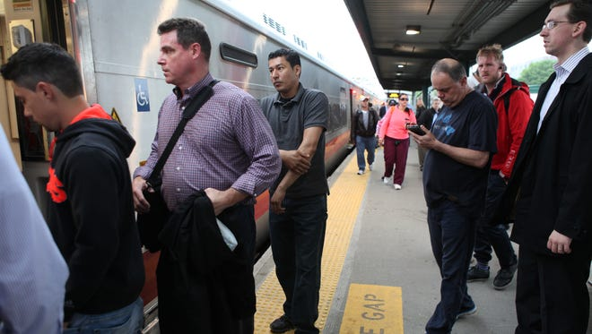 Commuters board a New York City train at the Metro-North Port Chester station in this file photo.