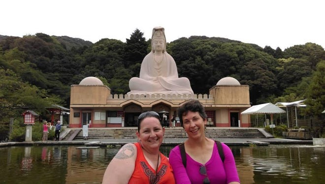 World of Inquiry School 58 teachers Jennifer Wagner, left, and Lisa Tilley, at a war memorial in Kyoto, Japan.