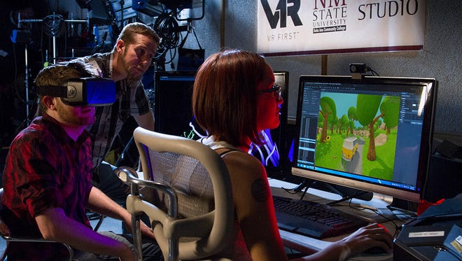 Assistant Professor Ian Snyder helps students develop a 3D game at Doña Ana Community College.